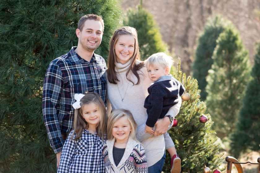 photography of family near pine tree